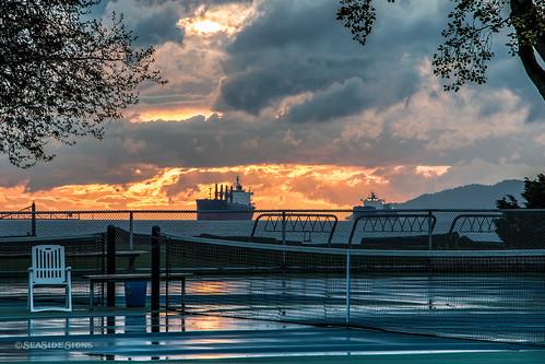sunset canada reflection rain vancouver britishcolumbia tennis kitsilano englishbay vancouverbc kitsbeach vancity gvrd metrovancouver itf vancouvercanada kitsilanobeachpark