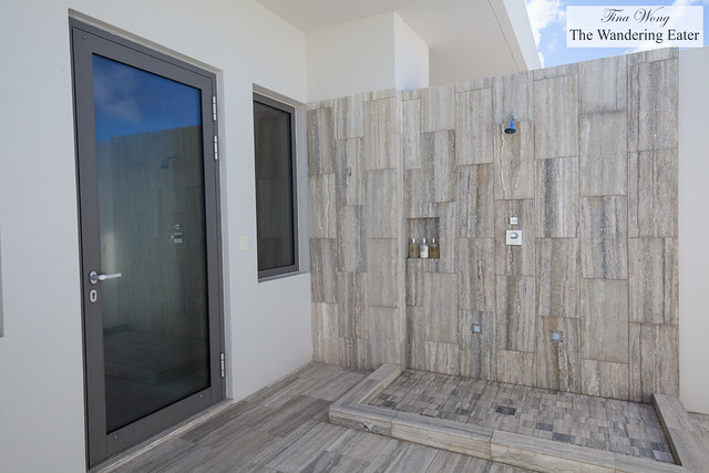 Outdoor marble shower at Moray Penthouse