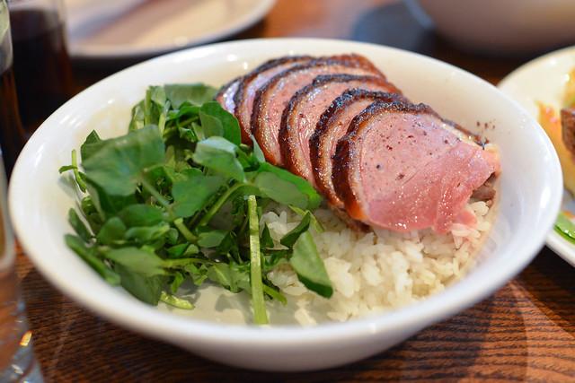 rotisserie duck over rice duck scallion, ssäm sauce, crispy shallot