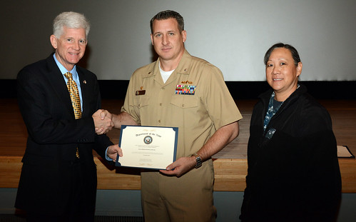 Yokosuka, Japan - USS Germantown (LSD-42) Commanding Officer, Cmdr. Gary  Harrington, (2nd from left)  receives the 2014 Energy and Water Management , Gold Level of Achievement, from  Chris Tindal, Director for Operational Energy, of the Deputy Assistant Secretary of the Navy Energy.