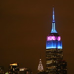 Empire State Building lit blue and purple