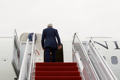 U.S. Secretary of State John Kerry boards his airplane at Andrews Air Force Base in suburban Washington, D.C., on March 25, 2015, as he heads to Switzerland to resume negotiations with Iranian officials about the future of their nuclear program. [State Department photo/ Public Domain]
