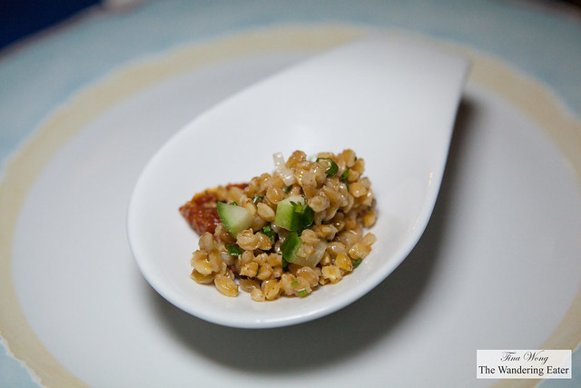 Amuse bouche of quinoa salad, cucumbers and dried tomatoes