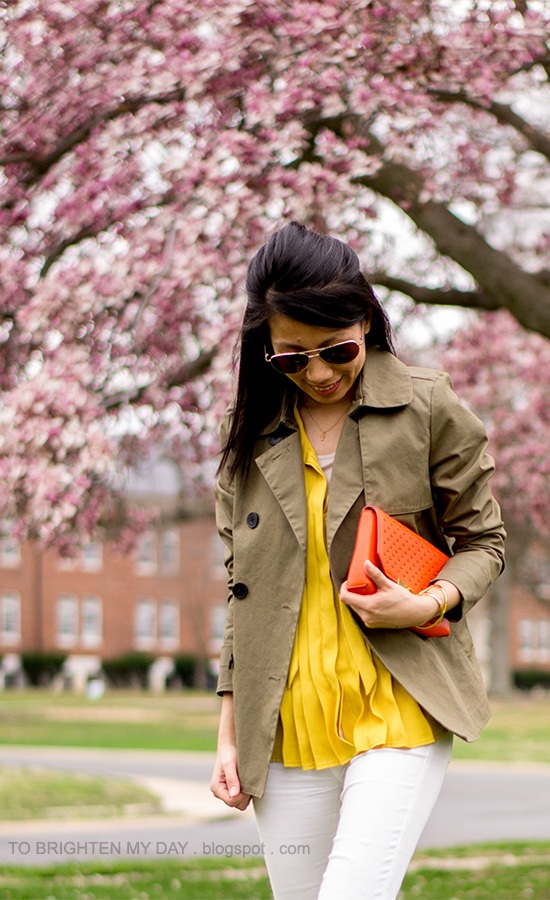 green swing jacket, mustard pleated top, white jeans, orange clutch
