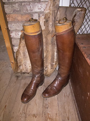 outdoor shoe(0.0), brown(1.0), footwear(1.0), wood(1.0), shoe(1.0), cowboy boot(1.0), tan(1.0), riding boot(1.0), boot(1.0),