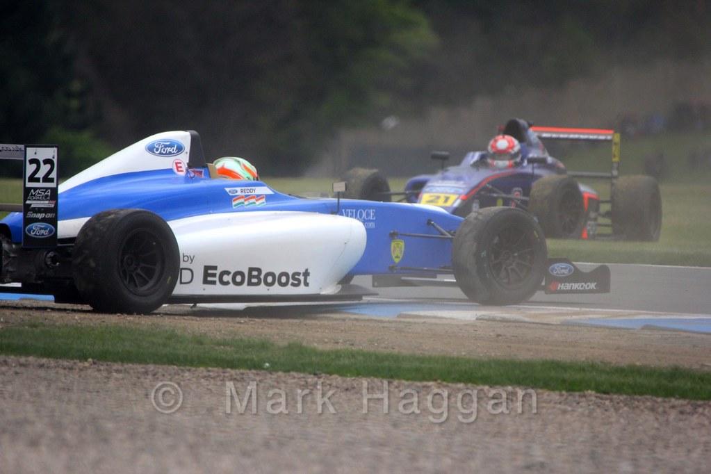 Petru Florescu and Tarun Reddy recover from an incident during MSA Formula racing at Donington Park, April 2015