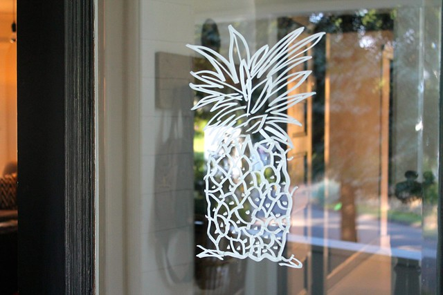 A pineapple using Sharpie paint pen on glass front door