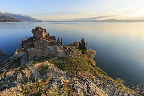macedonia ohrid sunsetsunrise skopje fyrom balcans skopjerepublicofmacedoniaohridlakeohridmonasterytra skopjerepublicofmacedoniaohridlakeohridmonasterytraditionalculturebyzantinechurchtravelorthodoxcliffmountainlandscapelakewaterarchitectureandbuildingsrocksummereuroperooftileorthodoxchurchsteepcobbleston