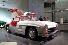 mercedes-benz 190sl(0.0), sports car(0.0), race car(1.0), automobile(1.0), vehicle(1.0), automotive design(1.0), mercedes-benz(1.0), auto show(1.0), mercedes-benz 300sl(1.0), antique car(1.0), sedan(1.0), classic car(1.0), vintage car(1.0), land vehicle(1.0), luxury vehicle(1.0), supercar(1.0), motor vehicle(1.0), classic(1.0),