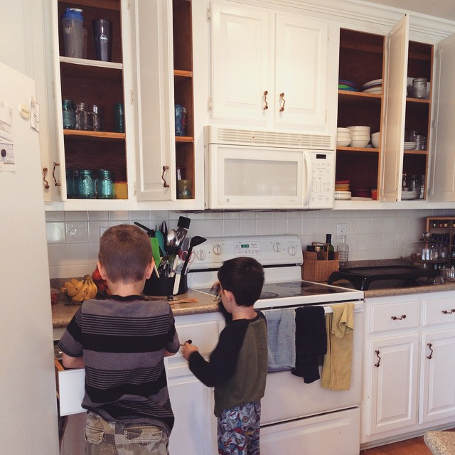 Taite (8) teaching Owen (5) how to put away silver ware. We make our boys empty the dish washer daily if not twice a day. They work together and it's done in less than 5 minutes. Owen hasn't been allowed to really help yet because he breaks to many glasse