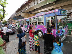 Bus commuters wait to take the next ride in Yangon. Over 300 public and private bus lines operate about 6,300 crowded buses around the city, carrying over 4.4 million passengers a day.