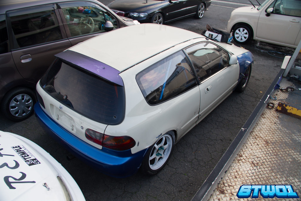 white car with blue and purple