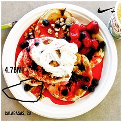 Today was pancake breakfast at work. I ate one plain, couple of blueberry, one banana and couple of chocolate chip pancakes with whipped cream, strawberry, blueberries, banana and boysenberry syrup. Because I can 😛 #nikeplus #run2eat #pa