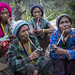 Tribal Chin Women From Muun Tribe With Tattoos On The Face Smoking, Mindat, Myanmar by Eric Lafforgue