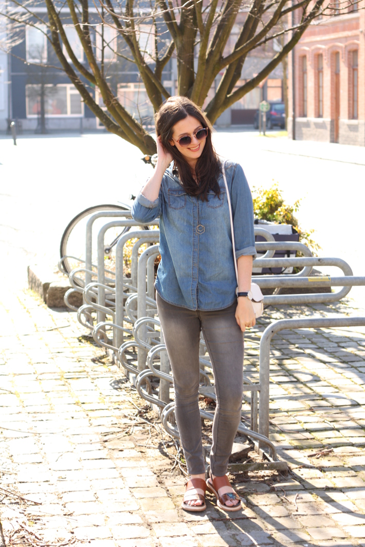 casual outfit: denim shirt, grey skinnies, snakeskin sandals and cross body bag