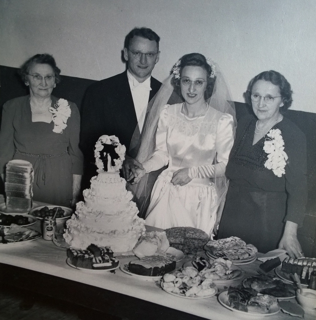 Grandma and Pop, cutting their wedding cake