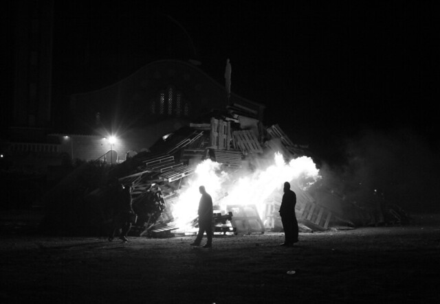 The village priest attending the bonfire lighting, Easter Saturday