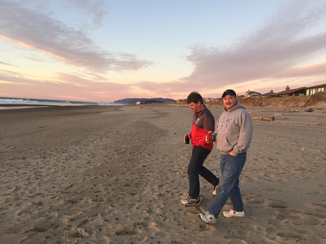 Ken and Jim strolling Salishan beach at Sunset