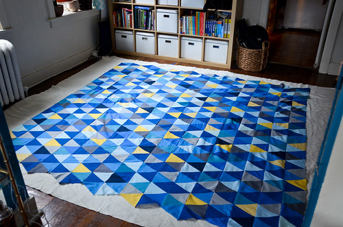 Step 3: Center Quilt Top Over Batting, Right Side Up