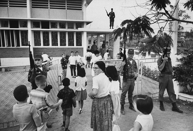 SAIGON Mar 1964 - American children attending grade school, guarded by US troops after Viet Cong terrorist bombing - Photo by Larry Burrows