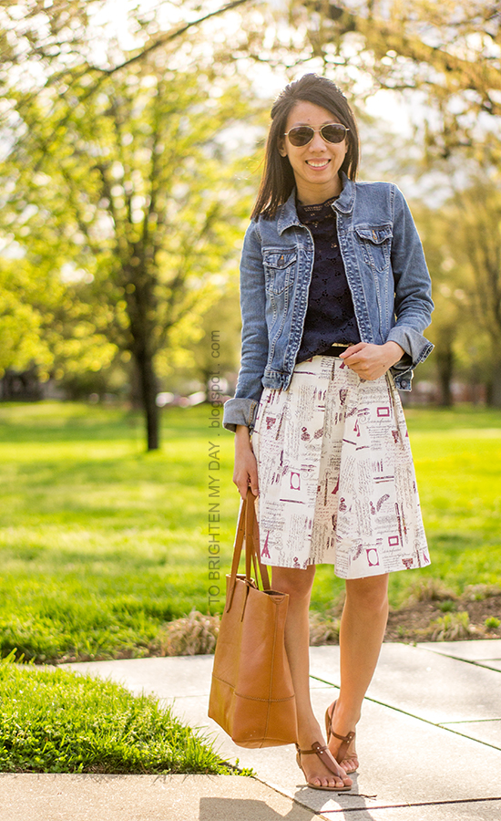 denim jacket, navy lace top, printed pleated skirt, brown sandals, cognac brown tote