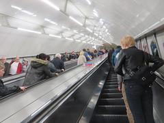 bullet train(0.0), high-speed rail(0.0), vehicle(0.0), train(0.0), transport(0.0), public transport(0.0), boarding(0.0), rapid transit(0.0), passenger(1.0), escalator(1.0),
