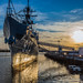 The USS Barry destroyer at the Washington Navy Yard reflects in the Anacostia River at sunset by joseph.gruber