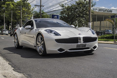 maserati granturismo(0.0), automobile(1.0), automotive exterior(1.0), wheel(1.0), vehicle(1.0), performance car(1.0), automotive design(1.0), fisker karma(1.0), bumper(1.0), sedan(1.0), personal luxury car(1.0), land vehicle(1.0), luxury vehicle(1.0), supercar(1.0), sports car(1.0),