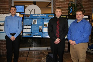 Precision Machining Process Design Team posing with poster