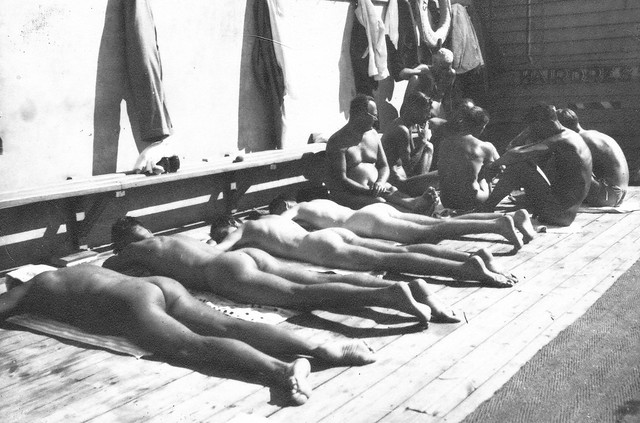 Sunbaking and playing cards, St Kilda Baths, late 1930s