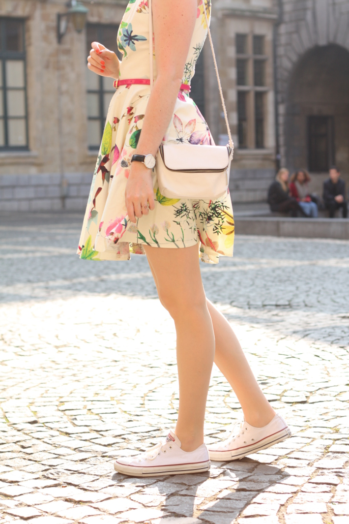 girly spring outfit: floral Closet London dress, white Converse