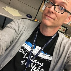 I'm wearing my #libraryoftheyear t-shirt, a #cardigan sweater, reading glasses, & my staff badge. I can't get more #librarian than this!