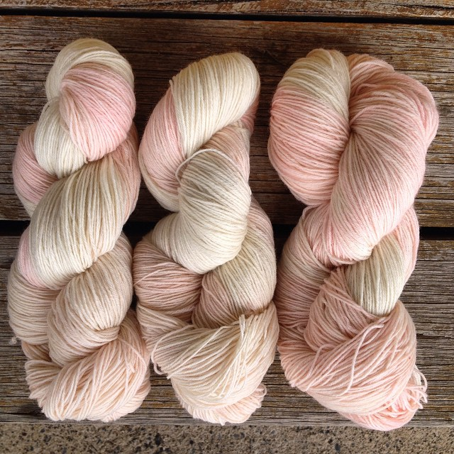 Three skeins of hand dyed sock yarn. Nailed the variegated soft pink I was after.
