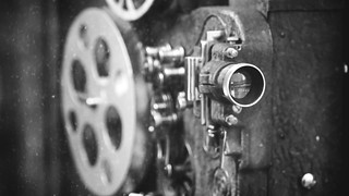 An early reel-to-reel film camera
