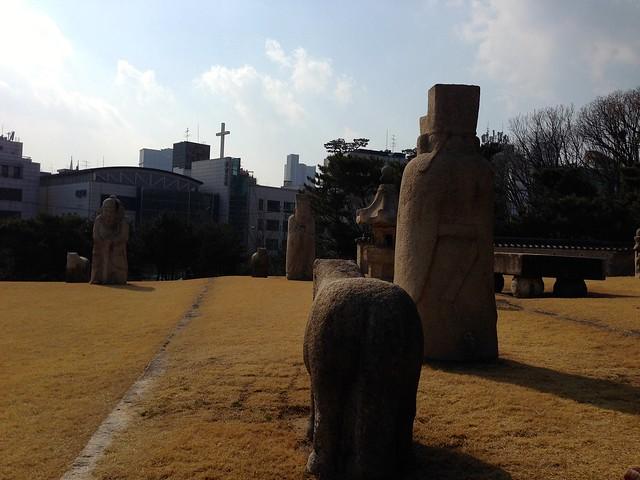 Stone figures around the burial mound