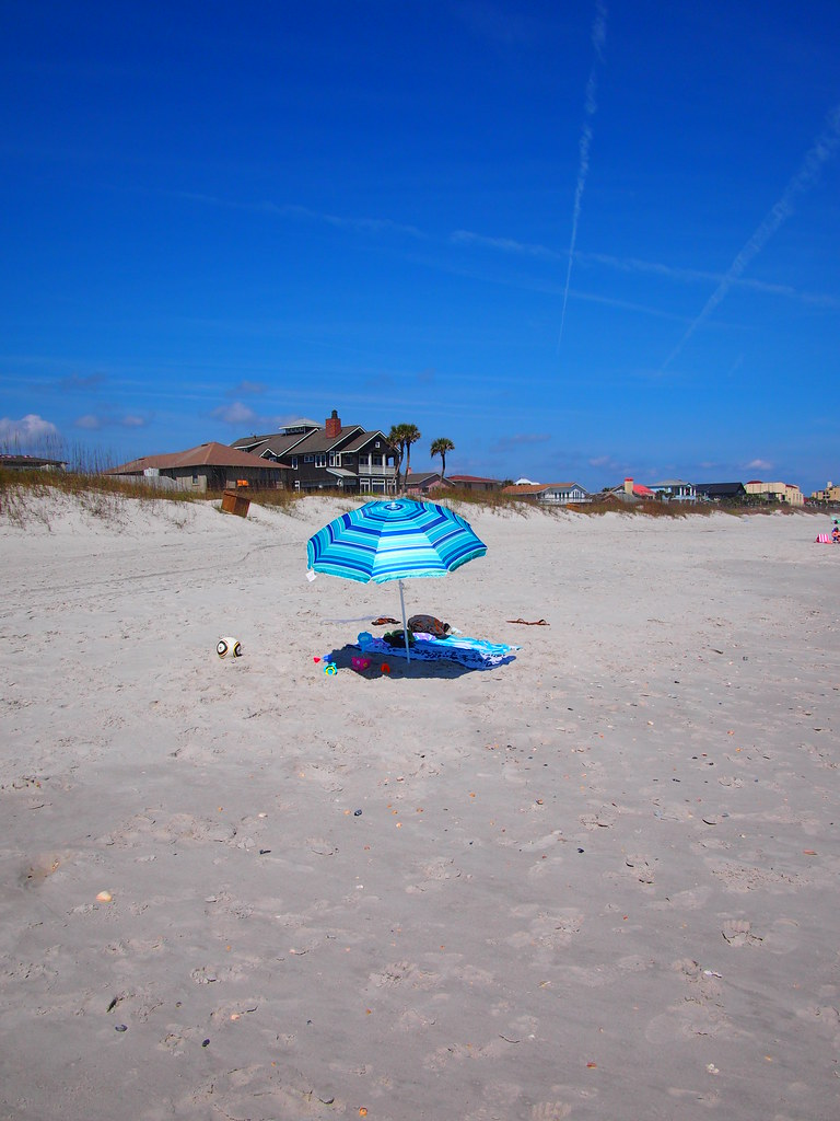 Beach scene, blue beach umbrella