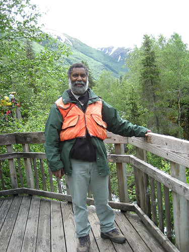 Robert Stovall, the deputy district ranger on the Seward Ranger District on Alaska's Chugach National Forest, takes a moment to relax at the Russian River Falls Overlook. As a sport fisherman he enjoys hooking the big, aggressive silvers, also known as coho salmon. (U.S. Forest Service photo)