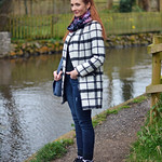 Black and white check coat with denim and Nike hi-tops