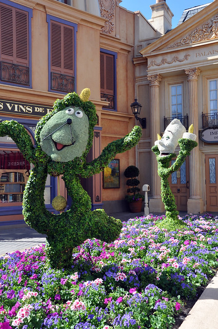 Cogsworth and Lumiere topiaries