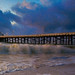 Malibu Pier during storm by Marvs Images
