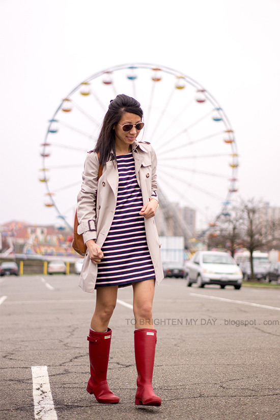 trench coat, striped dress, red rain boots, brown cognac tote