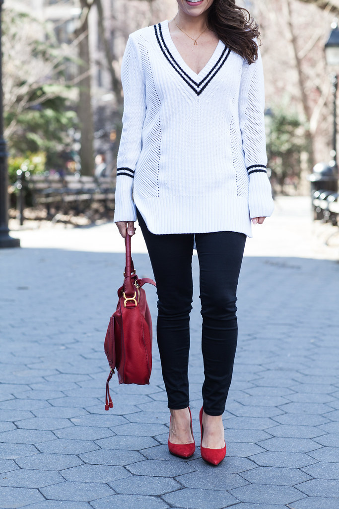 varsity sweater banana republic black skinny jeans white sweater red accents red chloe marcie bag red dvf bethany heels suede red heels nyc fashion blogger corporate catwalk spring look