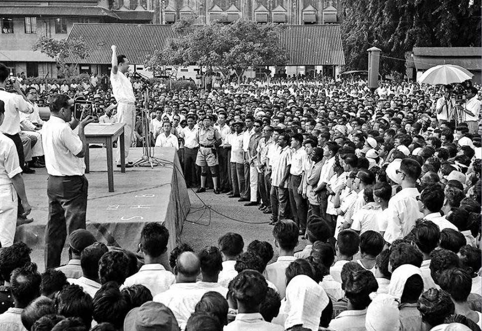 1963 HARBOUR WORKERS' UNREST: Mr Lee speaking to workers from the Singapore Harbour Board. When members of the Singapore Harbour Board Staff Association decided to proceed with a strike after he promised a S$2 million award for wage claims, he deregistered the union on July 22, 1963. - picture via ST files