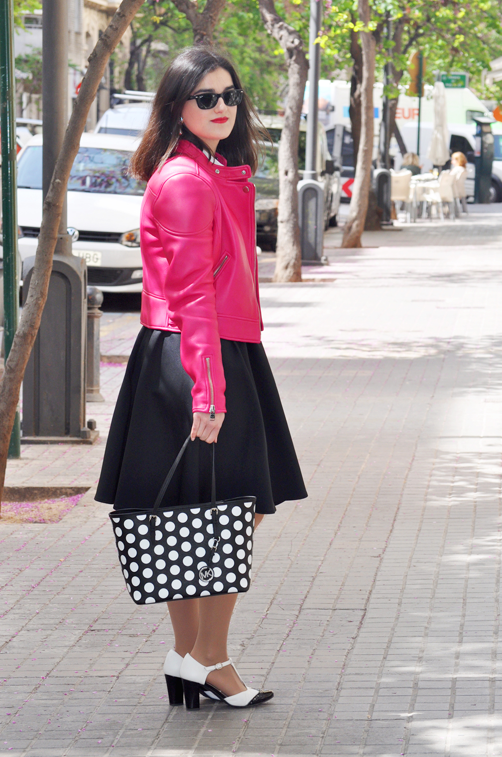 something fashion valencia blogger moda estilo style spain, coach hot pink biker jacket michael kors, spring blossom VLC vintage earrings outfit, fblogger estilismo lady mod style 50's midi skirt black, black and white hispanitas shoes heels zapatos, bloggers de moda valencia