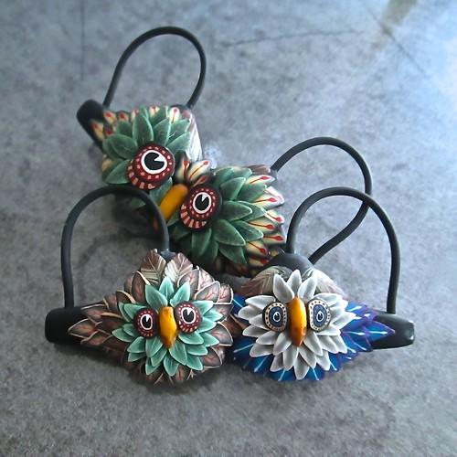 A pair of owl themed artisan 'bra' pins