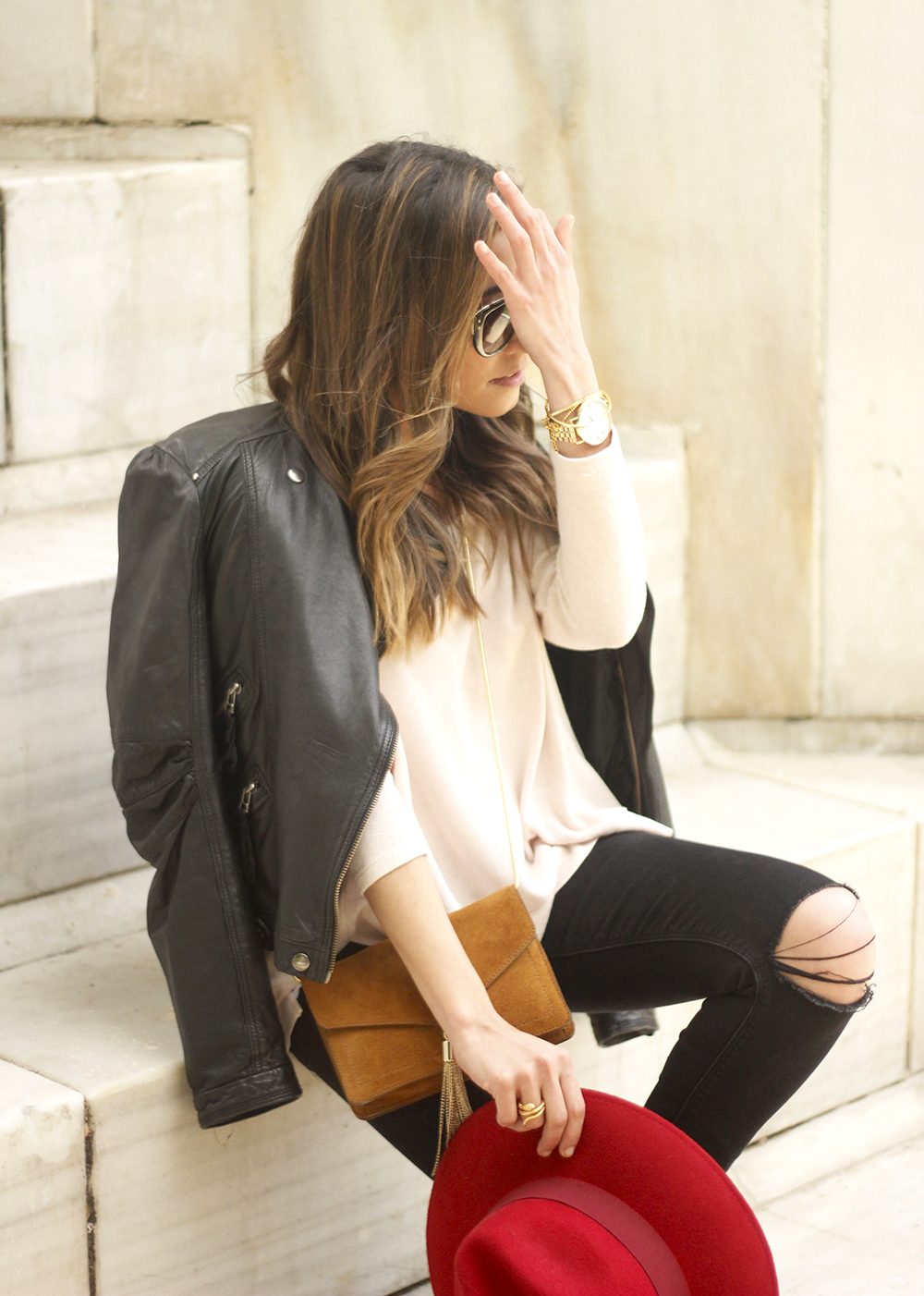black biker jacket ripped jeans red hat camel bag outfit fashion style spring07