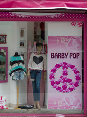dollhouse(0.0), doll(0.0), barbie(0.0), toy(0.0), purple(1.0), display window(1.0), pink(1.0),