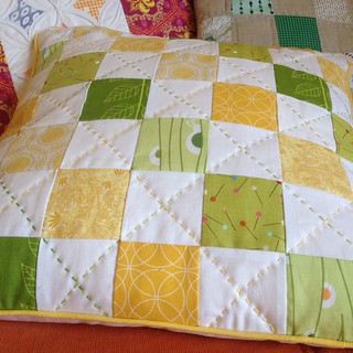 green and yellow hand quilted pillow