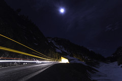 Mountain tunnel, moon, UPS truck.