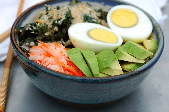 Warm rice bowl with ginger-tamari kale, avocado, pickled daikon and carrot, avocado and hard-boiled egg by Eve Fox, The Garden of Eating, copyright 2015